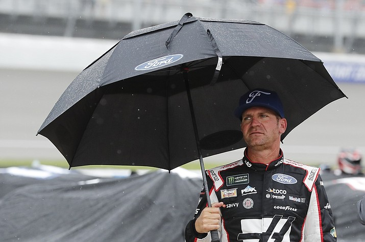Clint Bowyer stands on pit row waiting out the rain delay during the NASCAR cup series at Michigan International Speedway, Sunday, June 9, 2019, in Brooklyn, Mich. (Carlos Osorio/AP)