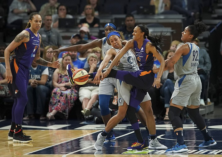 In this Thursday, June 6, 2019 photo, Minnesota Lynx forward Napheesa Collier defends against Phoenix Mercury forward DeWanna Bonner, second from right, during the first quarter of a WNBA game in Minneapolis. The Mercury trumped the Indian Fever 94-87 on Sunday, June 9, to bring their record back up to .500 in Indianapolis. (Jeff Wheeler/Star Tribune via AP, file)