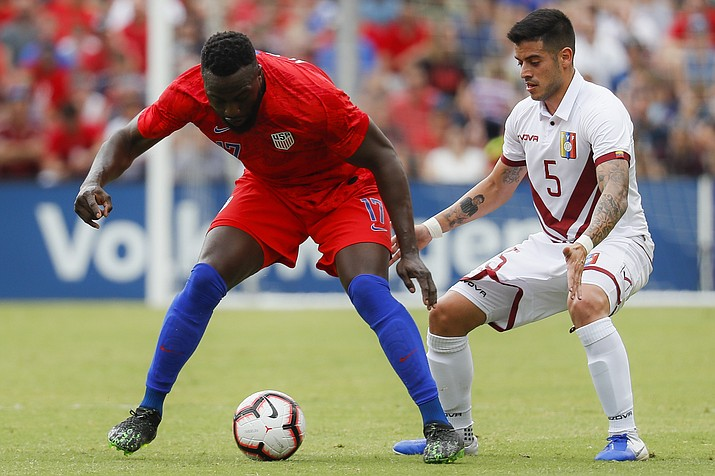 United States forward Jozy Altidore (17) and Venezuela midfielder Junior Moreno (5) vie for the ball during the second half of an international friendly match, Sunday, June 9, 2019, in Cincinnati. (John Minchillo/AP)