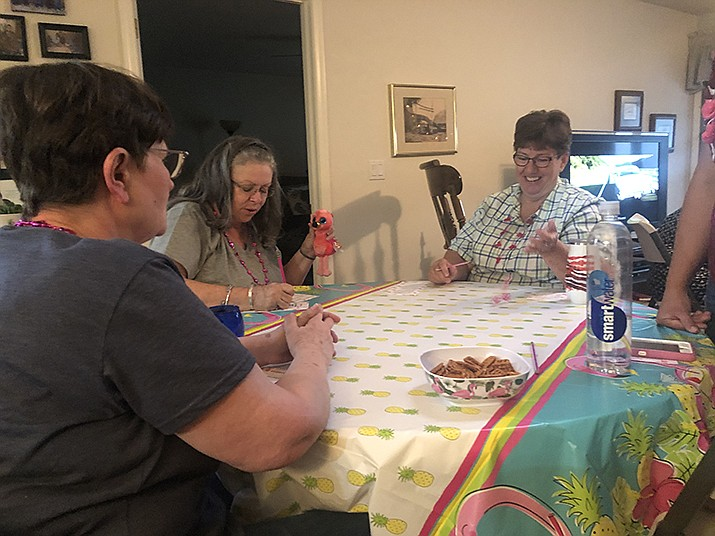Diane Glenn (right) and Eileen Daly (left) playing Bunco. (Photo by Agata Popeda/Daily Miner)
