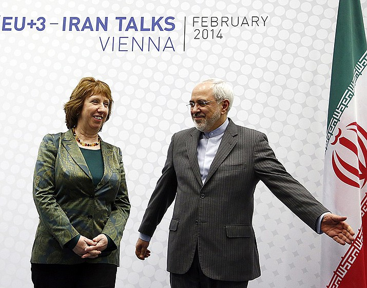 """Iran's foreign minister Mohammad Javad Zarif with Catherine Ashton in 2014. Zarif warned the U.S. on Monday that it """"cannot expect to stay safe"""" after launching what he described as an economic war against Tehran. (Photo by Österreichische Außenministerium, cc-by-sa-2.0, https://bit.ly/2XBuWcA)"""
