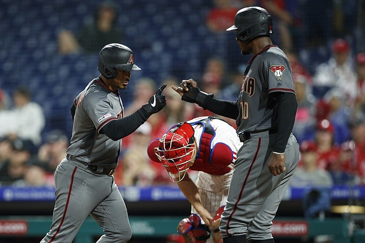Arizona Diamondbacks' Eduardo Escobar, left, and Adam Jones, right, celebrate past Philadelphia Phillies catcher J.T. Realmuto after Escobar's two-run home run off starting pitcher Jerad Eickhoff during the fourth inning of a game, Monday, June 10, 2019, in Philadelphia. (Matt Slocum/AP)