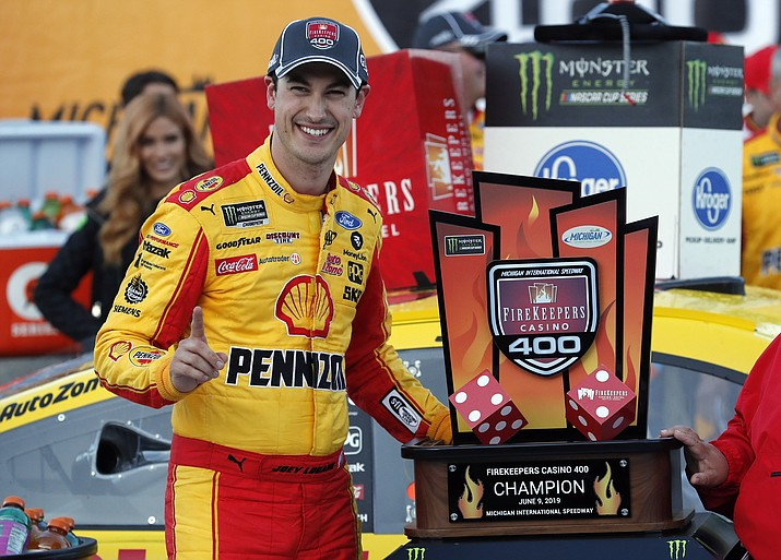 Joey Logano stands with the trophy after winning a NASCAR Cup Series auto race at Michigan International Speedway, Monday, June 10, 2019, in Brooklyn, Mich. (Carlos Osorio/AP)