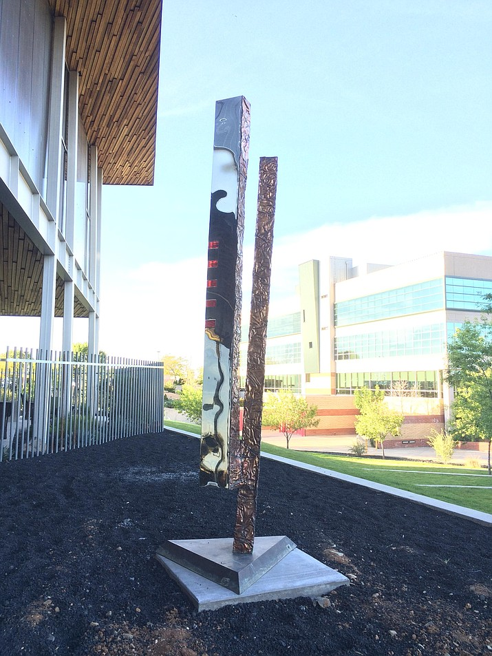 """Totem #1"" by Gary Slater stands east of the Prescott Valley Public Library. Council will vote on its purchase at the June 13 council meeting. (Sue Tone/Tribune)"