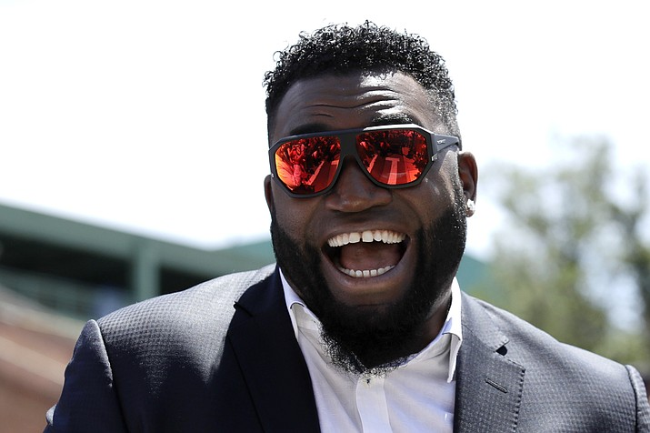 In this June 22, 2017, photo, retired Boston Red Sox designated hitter David Ortiz, smiles outside Fenway Park in Boston. Ortiz returned to Boston for medical care after being shot in a bar Sunday, June 9, 2019, in his native Dominican Republic. (Charles Krupa/AP, File)