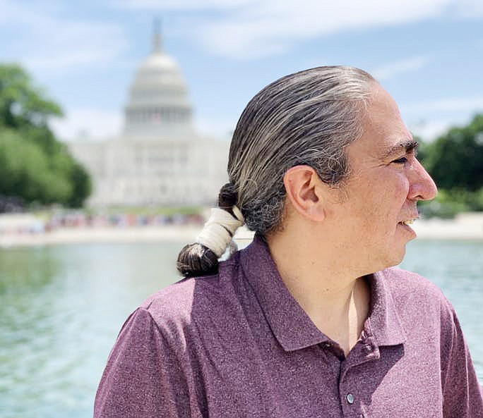 Mark Charles, presidential candidate for the 2020 election, stands in front of the Capitol in Washington D.C. (Jourdan Bennett-Begaye/Indian Country Today)