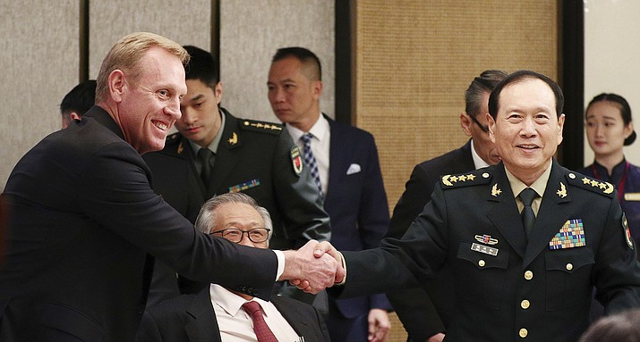 Acting U.S. Secretary of Defense Patrick Shanahan, left, shakes hands with Chinese Minister of National Defense Gen. Wei Fenghe, right, during a ministerial luncheon June 1, 2019, on the sidelines of the 18th International Institute for Strategic Studies (IISS) Shangri-la Dialogue in Singapore. (Yong Teck Lim/AP, File)
