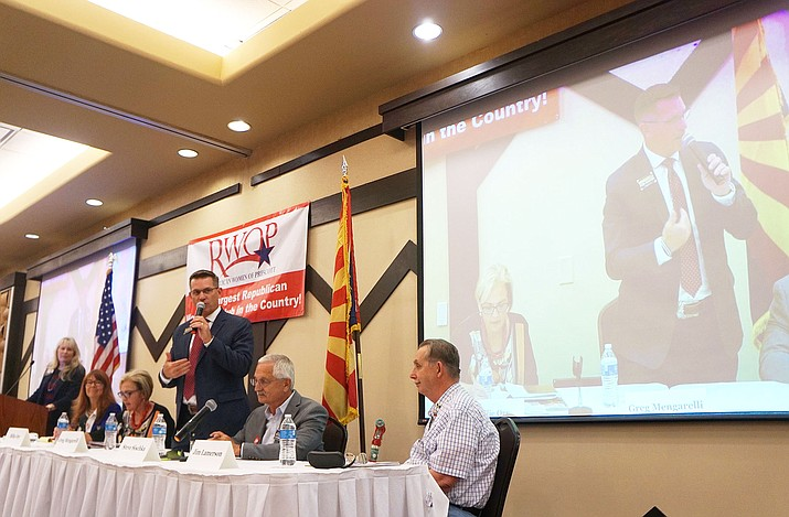 Prescott Mayor Greg Mengarelli, center, who is running unopposed for a second term, talks to the crowd during a Republican Women of Prescott luncheon forum on Tuesday, June 11, at the Prescott Resort while other candidates look on. (Cindy Barks/Courier)