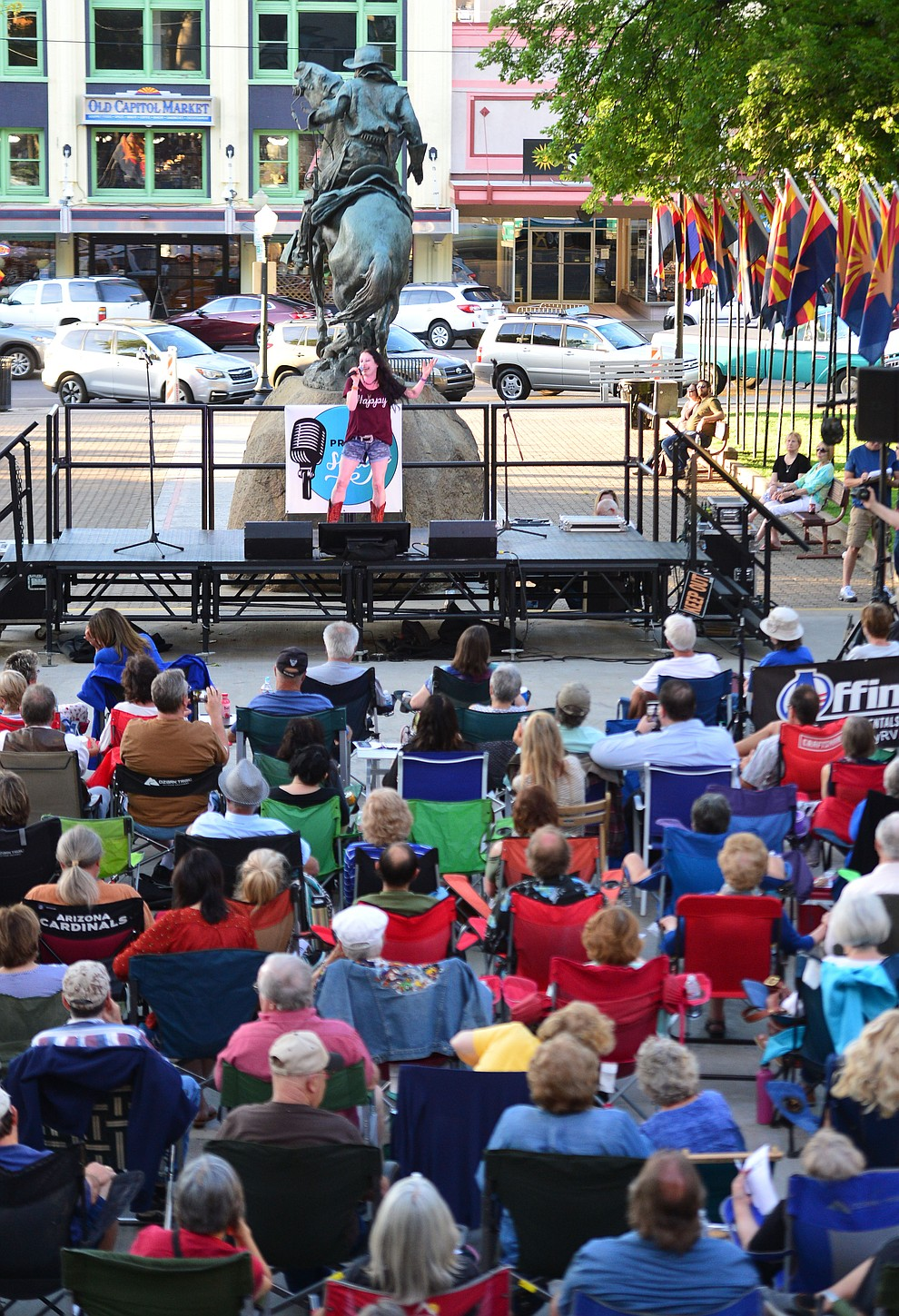 Desirae Yourgules sings Praying by Keesha as Prescott Sings, formerly Prescott Idol, opens their 10th season Thursday, June 6 on the Courthouse Plaza. (Les Stukenberg/Courier)