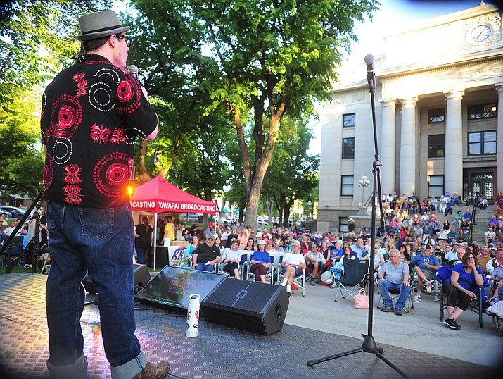 "Jeremiah Wilmot sings Phil Collins' song ""In the Air Tonight"" as Prescott Sings, formerly Prescott Idol, opens its 10th season Thursday, June 6 on the courthouse plaza. (Les Stukenberg/Courier)"