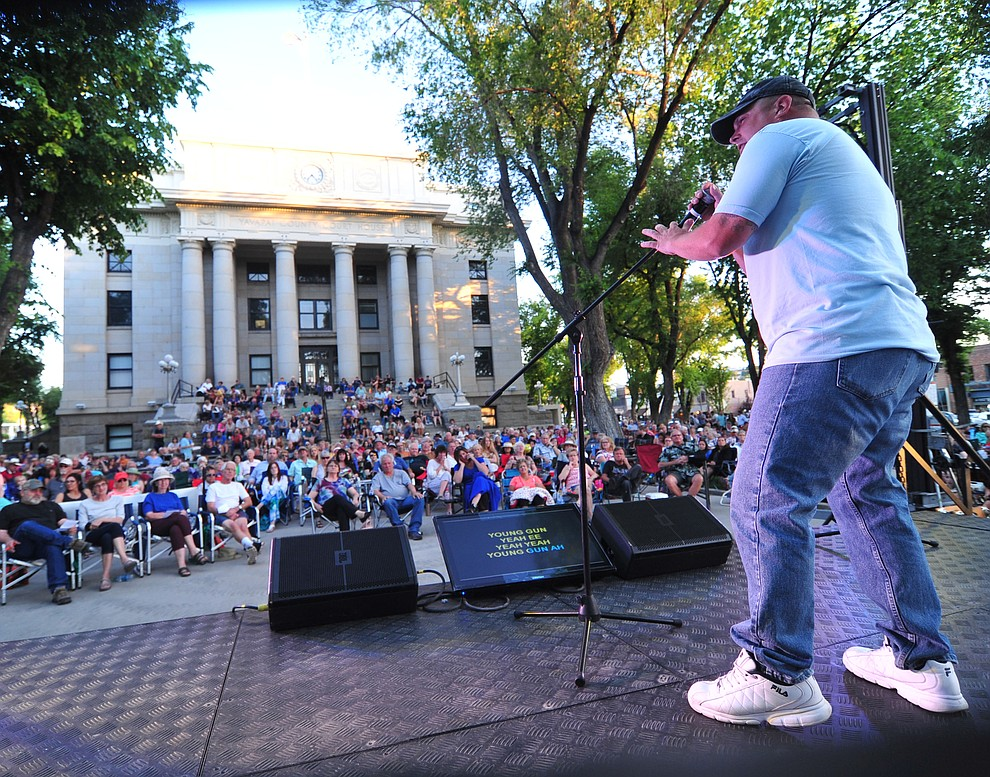 Brian Aguiniga sings Blaze of Glory by Bon Jovi as Prescott Sings, formerly Prescott Idol, opens their 10th season Thursday, June 6 on the Courthouse Plaza. (Les Stukenberg/Courier)
