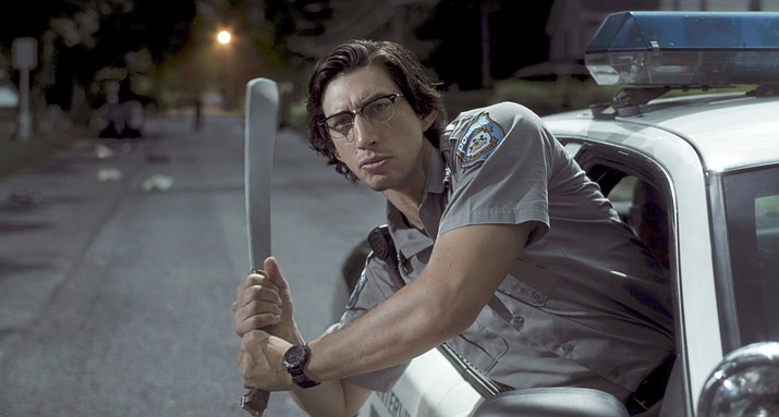 "In this image released by Focus Features shows Adam Driver as ""Officer Ronald Peterson"" in a scene from ""The Dead Don't Die."" (Frederick Elmes /Focus Features via AP)"
