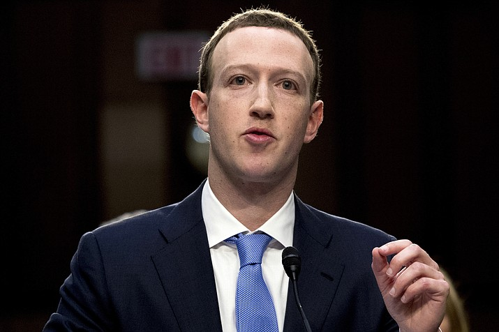 Facebook CEO Mark Zuckerberg testifies before a joint hearing of the Commerce and Judiciary Committees on April 10, 2018, on Capitol Hill in Washington. Weeks after Facebook refused to remove a doctored video of House Speaker Nancy Pelosi slurring her words, Zuckerberg is getting a taste of his own medicine: fake footage showing him gloating over his one-man domination of the world. (Andrew Harnik/AP, File)
