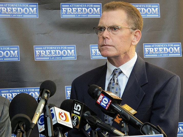 Douglas Haig takes questions from reporters at a news conference Feb. 2, 2018, in Chandler. A trial date has been reset for Haig, who is facing a federal ammunition-manufacturing charge in Las Vegas in connection with the deadliest mass shooting in the nation's modern history. (Brian Skoloff/AP, File)