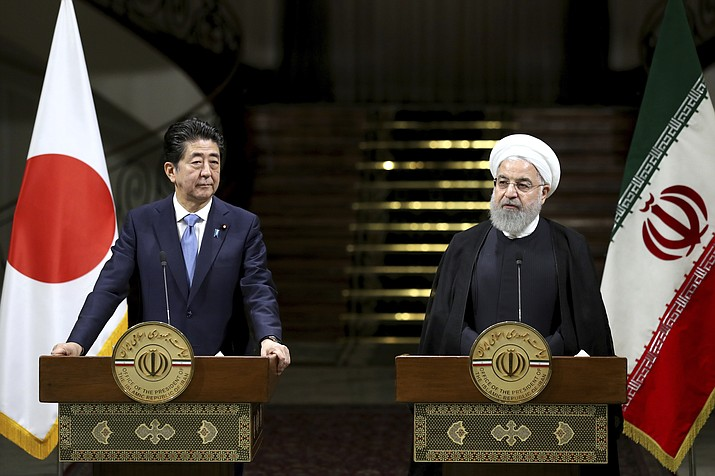Iranian President Hassan Rouhani, right, speaks with media during a joint press conference with Japanese Prime Minister Shinzo Abe, after their meeting at the Saadabad Palace in Tehran, Iran, Wednesday, June 12, 2019. The Japanese leader is in Tehran on an mission to calm tensions between the U.S. and Iran. (Ebrahim Noroozi/AP)
