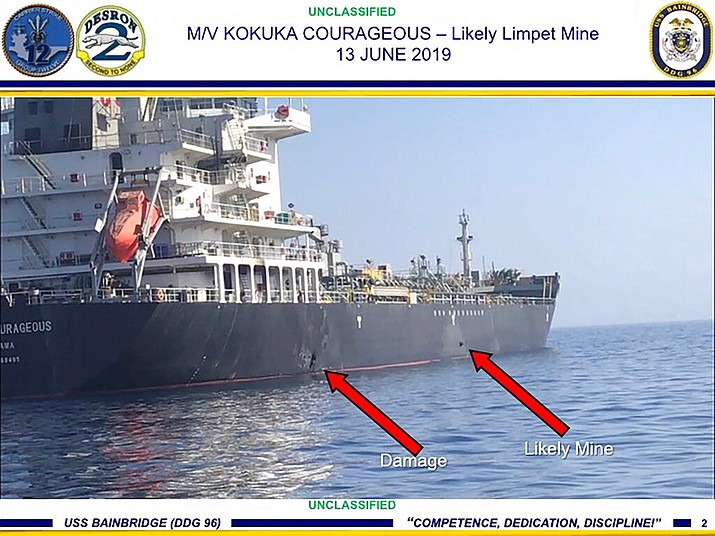 Damage and a suspected mine can be seen on the Kokuka Courageous in the Gulf of Oman near the coast of Iran. The U.S. military on Friday, June 14, 2019, released a video it said showed Iran's Revolutionary Guard removing an unexploded limpet mine from one of the oil tankers targeted near the Strait of Hormuz, suggesting the Islamic Republic sought to remove evidence of its involvement from the scene. (U.S. Central Command)