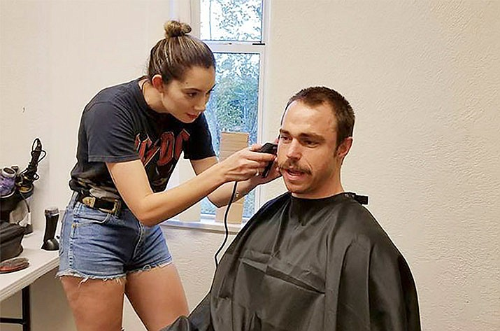 "Andrew William Steel, who portrays Frank Shankwitz in ""Wish Man,"" gets his hair cut for production while shooting in the Prescott area in 2017. The Prescott Film Festival will be discussing films ""Made in Yavapai County!"" at 4 p.m. Friday, June 14, at the Yavapai College Art Gallery, 1100 E. Sheldon St., as part of the festival which concludes this weekend. (Frank Shankwitz/Courtesy)"