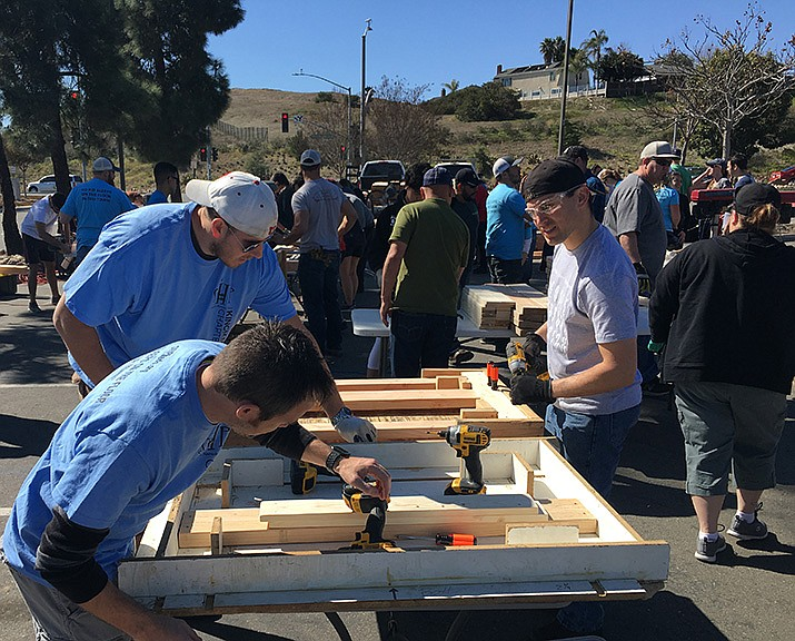 David Wayt (front), Scott Holtry (back left), and numerous volunteers learn the proper way to build beds at Sleep in Heavenly Peace's training held Feb. 24, 2018 in San Diego. (Courtesy file photo)