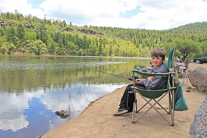 Hunter Matthews of Williams tries his luck fishing for trout at City Reservoir June 5. (Wendy Howell/WGCN)