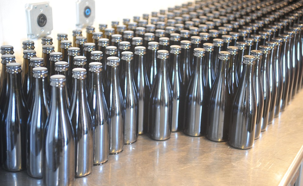 Bottles wait to be labeled at the Stoic Cider orchard and bottling facility Tuesday, May 29 in Williamson Valley northwest of Prescott. (Les Stukenberg/Courier)