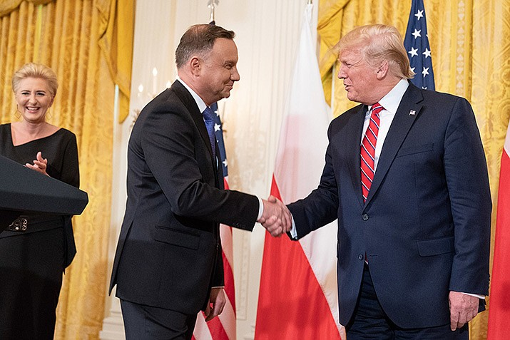President Donald J. Trump shakes hands with Polish President Andrzej Duda after delivering remarks at a Polish-American Reception Wednesday, June 12, 2019, in the East Room of the White House. (Official White House Photo by Shealah Craighead)