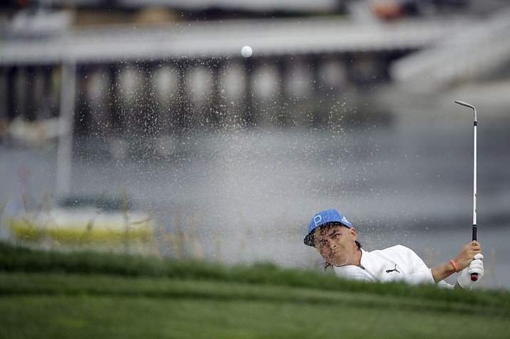 Rickie Fowler hits out of the bunker on the sixth hole during the first round of the U.S. Open Championship Thursday, June 13, 2019, in Pebble Beach, Calif. Fowler finished the round at 5-under par, 66. (Marcio Jose Sanchez/AP)