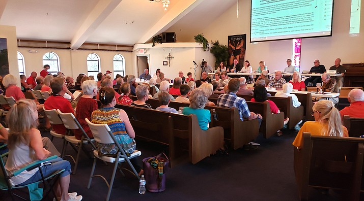 The stipulations to the rezoning were explained and public opinions were given to the Big Park Community Council.  Concerns on public safety were paramount, as a fire in Jack's Canyon would seriously endanger the residents trying to get out due to the added traffic jam the hotel would cause. Blocked views and heavy pedestrian traffic from the hotel were also concerns. The community's voice carried the day. Photo by Nancy Maple