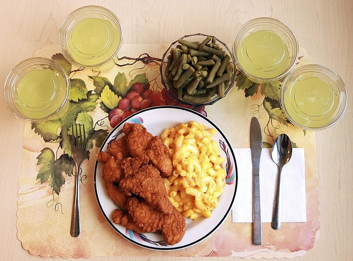"An ""ultra-processed"" lunch including brand name macaroni and cheese, chicken tenders, canned green beans and diet lemonade. Researchers found people ate an average of 500 extra calories a day when fed mostly processed foods, compared with when the same people were fed minimally processed foods. (Paule Joseph, Shavonne Pocock/NIH)"