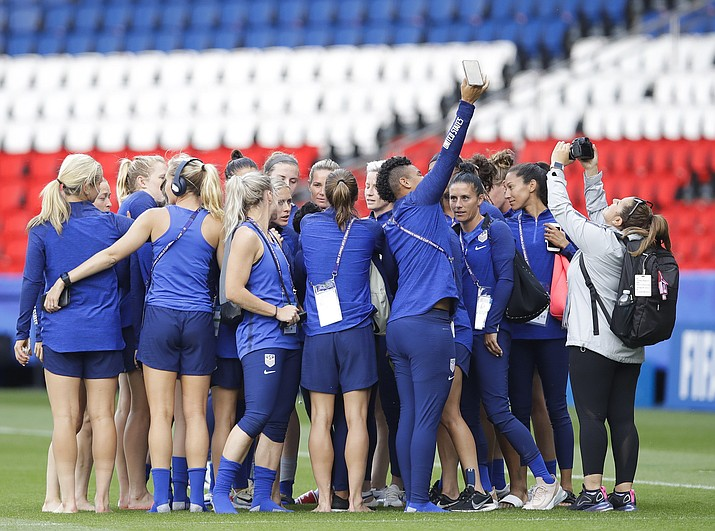 United States players take photos during a visit at the Parc des Princes stadium a day before the Group F soccer match between United States and Chile at the Women's World Cup in Paris, Saturday, June 15, 2019. (Alessandra Tarantino/AP)