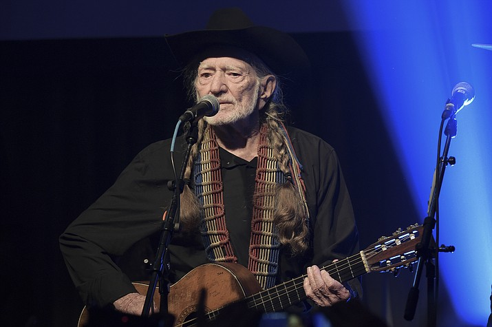 In this Feb. 6, 2019 file photo, Willie Nelson performs at the Producers & Engineers Wing 12th Annual GRAMMY Week Celebration at the Village Studio in Los Angeles. Nelson s latest studio offering, Ride Me Back Home, is a relaxed, joyous collection that finds Nelson reflecting, explicitly, on age and its toll - complaining, in fact, about the way time has left his face so lined - but free of any self-pity. It's more of a celebration than some of his recent albums, and more of a showcase for his deceptively simple guitar work, which still carries an emotional wallop with its easy tone and subtlety. (Richard Shotwell/Invision/AP, File)