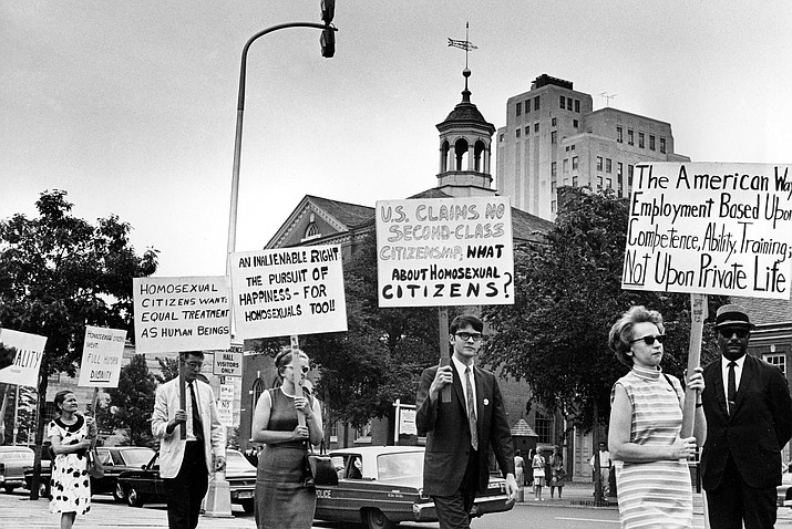 In this July 4, 1967 file photo Kay Tobin Lahusen, right, and other demonstrators carry signs calling for protection of homosexuals from discrimination as they march in a picket line in front of Independence Hall in Philadelphia. In 2019, same-sex marriage is the law of the land in the U.S. and at least 25 other countries. LGBT Americans serve as governors, big-city mayors and members of Congress, and one _ Pete Buttigieg _ is waging a spirited campaign for president. (John F. Urwiller/AP, file)