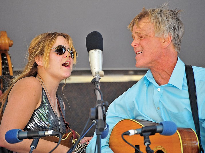 Jessie and her dad Brian Burnett perform with the other members of their family in the Burnett Family Bluegrass band during the 31st Annual Bluegrass Festival in downtown Prescott in 2016. (Courier file)