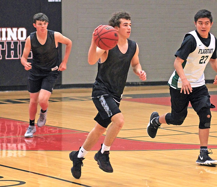Zain Grantham brings the ball down court during a Coconino High School Summer League game. (Wendy Howell/WGCN)