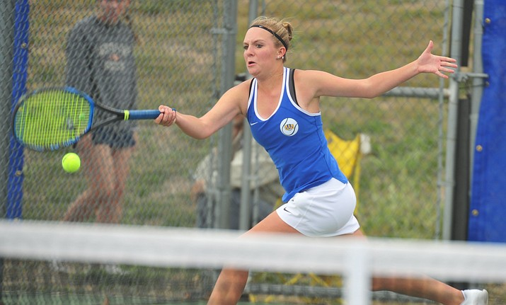 Prescott's Ava Andrews hits a return shot as the Badgers play Ironwood Ridge in the first round of the AIA State Team Tennis Tournament Tuesday, April 23 in Prescott. Andrews was selected to The Daily Courier's Spring 2019 All-Courier girls tennis team. (Les Stukenberg/Courier, file)