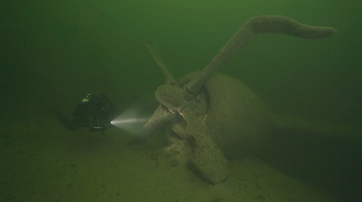 A diver from NPS' Submerged Resources Center assesses the B-29 for natural deterioration and any damage potentially done to the wreckage by divers. (Photo/NPS)