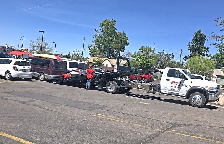 Williams Police have a van towed that was connected to suspects passing counterfeit money June 11. (Wendy Howell/WGCN)