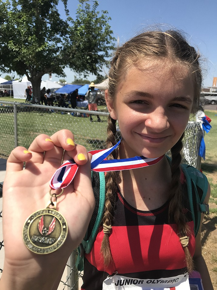 Mia Fisher shows off her gold medal after winning the high jump event at the Arizona Junior Olympic Championships on Sunday, June 16, 2019. (Prescott Flyers/Courtesy)