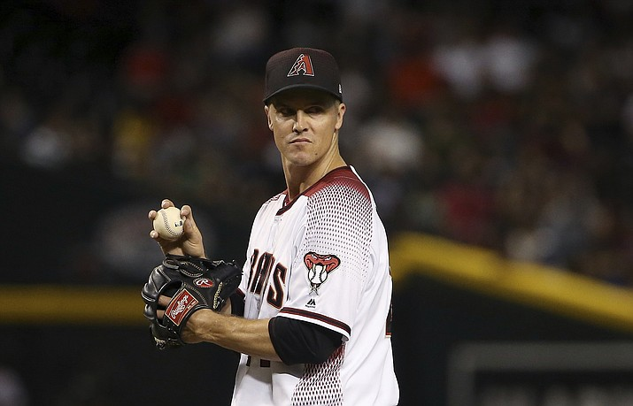 Arizona Diamondbacks starting pitcher Zack Greinke pauses on the mound after giving up a two-run double to Colorado Rockies' Ryan McMahon during the seventh inning Wednesday, June 19, 2019, in Phoenix. (Ross D. Franklin/AP)