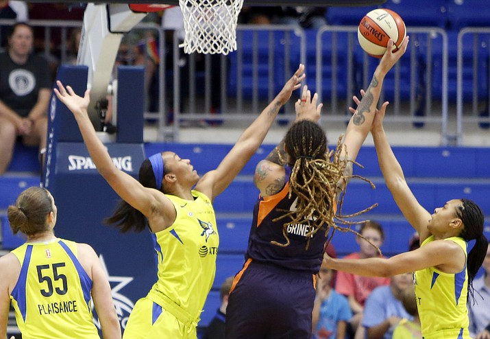 Phoenix Mercury center Brittney Griner (42) shoots between Dallas Wings center Imani McGee-Stafford, left, and Allisha Gray, right, during the first half of a WNBA basketball game Thursday, June 20, 2019, in Arlington, Texas. At left is Wings forward Theresa Pleasance (55). (Steve Hamm/The Dallas Morning News via AP)