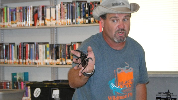 Wildman Phil shows off a tarantula during a visit to Cordes Lakes. He will bring his  array of creatures to the Prescott Public Library, 215 E. Goodwin St., at 1 p.m. Thursday, June 27. (Courier file photo)