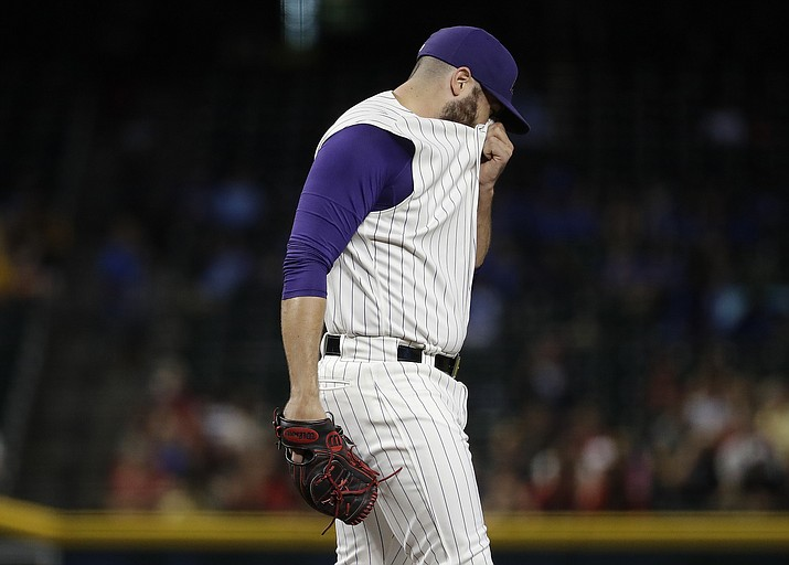 Arizona Diamondbacks starting pitcher Robbie Ray walks off the mound after giving up a home run against the Colorado Rockies during the first inning Thursday, June 20, 2019, in Phoenix. (Matt York/AP)