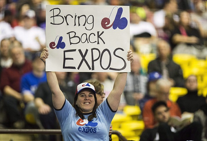 A fan holds up a sign during a pregame ceremony as the Toronto Blue Jays face the Cincinnati Reds on April 3, 2015, in an exhibition baseball game in Montreal. (Paul Chiasson/The Canadian Press via AP, File)