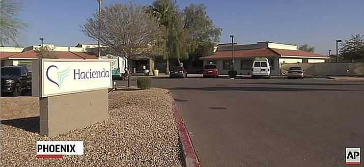 The Hacienda HealthCare facility in Phoenix. Federal officials have told the long-term care facility where an incapacitated woman was raped and gave birth last year will lose Medicaid participation.  (Photo capture via AP Video)