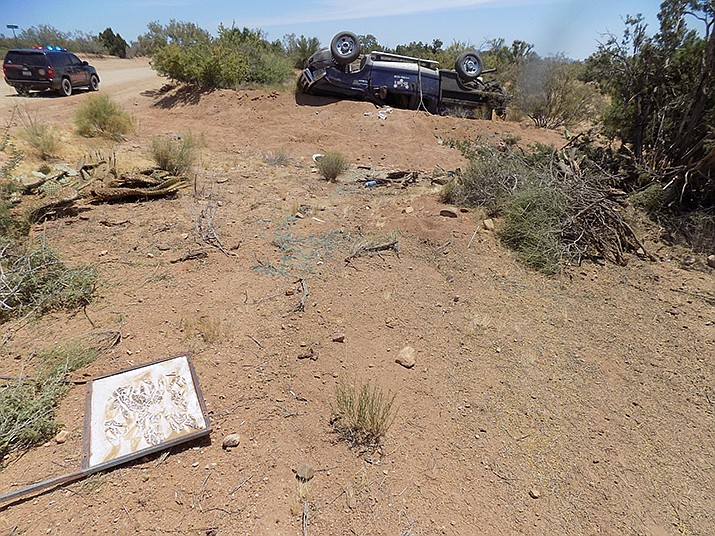Initial investigation indicates the driver over corrected as he negotiated a turn and lost control, striking the ditch and rolling into an empty field. Yucca Fire District and American Medical Response responded along with a CareFlight helicopter. (Courtesy)