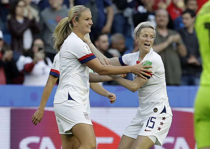 United States' Lindsey Horan, left, is congratulated by teammate Megan Rapinoe after scoring her team's first goal during the Women's World Cup Group F match against Sweden at Stade Oc ane, in Le Havre, France, Thursday, June 20, 2019. (Alessandra Tarantino/AP)