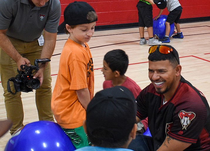 Eduardo Escobar said growing up poor in Venezuela made him appreciate how much his visits mean to children, like these at the Boys & Girls Clubs of Metro Phoenix – MLB All Star D-Backs Branch. (Photo by Brady Vernon/Cronkite News)