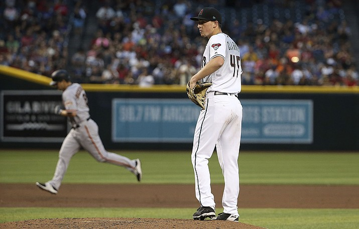 Arizona Diamondbacks starting pitcher Taylor Clarke pauses on the mound after giving up a grand slam to San Francisco Giants' Alex Dickerson, left, during the third inning Friday, June 21, 2019, in Phoenix. (Ross D. Franklin/AP)