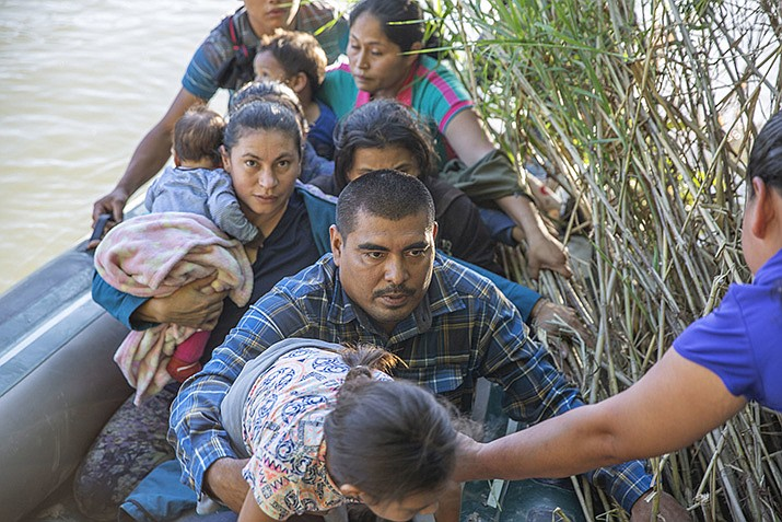 Migrants illegally enter the U.S. by crossing the Rio Grande in rubber boats near Los Ebanos, Texas on June 15, 2019. A panel of appeals court judges in California will hear arguments in the long-running battle between advocates for immigrant children and the U.S. government over conditions in detention and holding facilities near the southwest border. (Photo by Kris Grogan, CBP Office of Public Affairs)