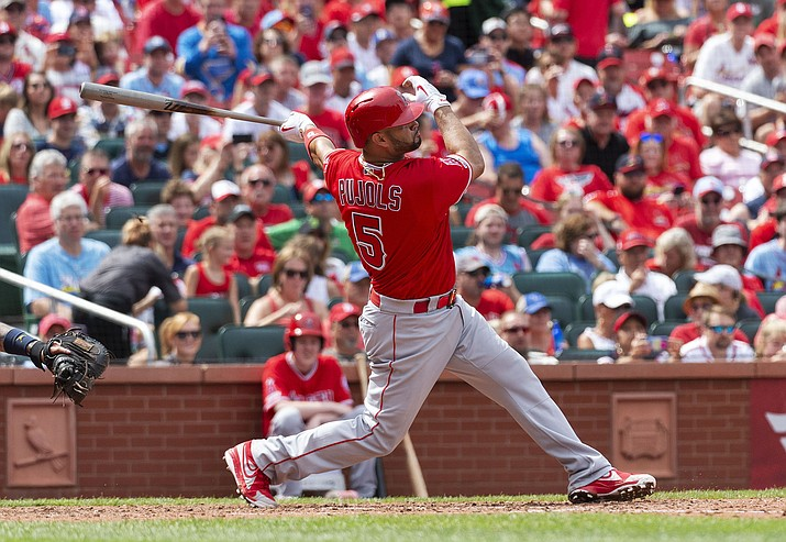 Los Angeles Angels' Albert Pujols hits a home run during the seventh inning against the St. Louis Cardinals, Saturday, June 22, 2019, in St. Louis. (L.G. Patterson/AP)