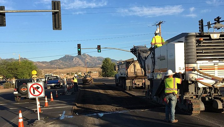City of Kingman workers at the intersection of Stockton Hill Road, Hualapai Mountain Road and Andy Devine Avenue replacing asphalt. (File photo courtesy of City of Kingman Public Works)